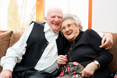 couple with dementia hugging