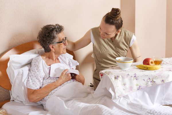 Live-In carer helping person with multiple sclerosis